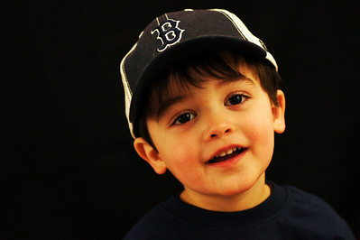 Play Ball!!! The Red Sox season opener is tomorrow...I tried to get a shot of the boy wearing his 2011 Red Sox hat, but I'm finding it quite difficult to shoot a 2 year old. It's nearly impossible to keep him still - lol