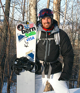 PHOTO BY HERB SWANSON, FEB. 28, 2009: Olympic Gold Medalist Seth Wescott poses with his snowboard in the mountains of Maine.PHOTO BY HERB SWANSON: