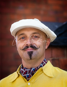 Man with waxed moustache, 1940s style