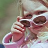 Younf child with sunglasses.