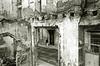 man-on-street-thru-ruins