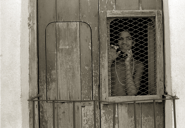 boy-in-window-Trinidad