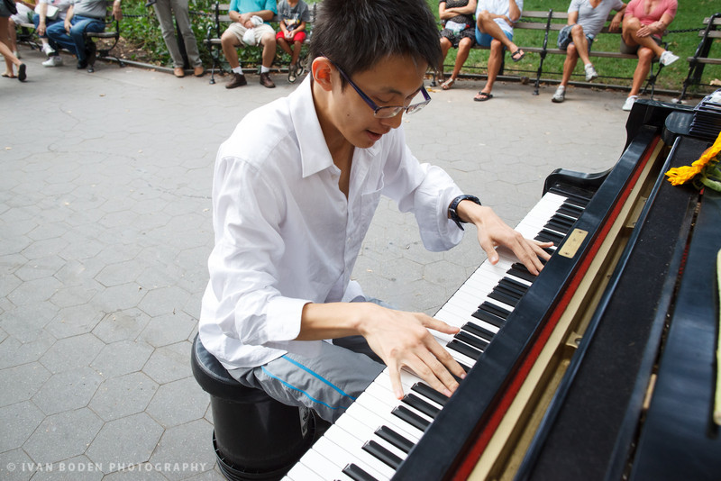 NYU Student playing his own composition in Washington Square Park, NYC.