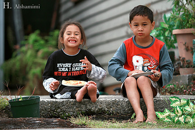 Two Maori kids having their lunch (or breakfast? can't remember) in Rotorua, NZ.