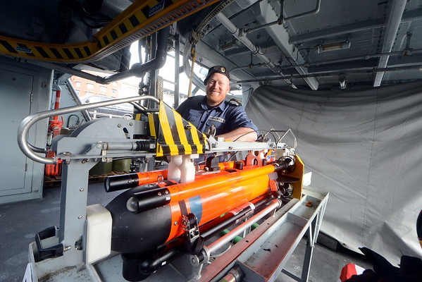 A portrait on board HMS Ledbury of Leading Seaman, Lee Roberts with the ships Seafox  ROV.