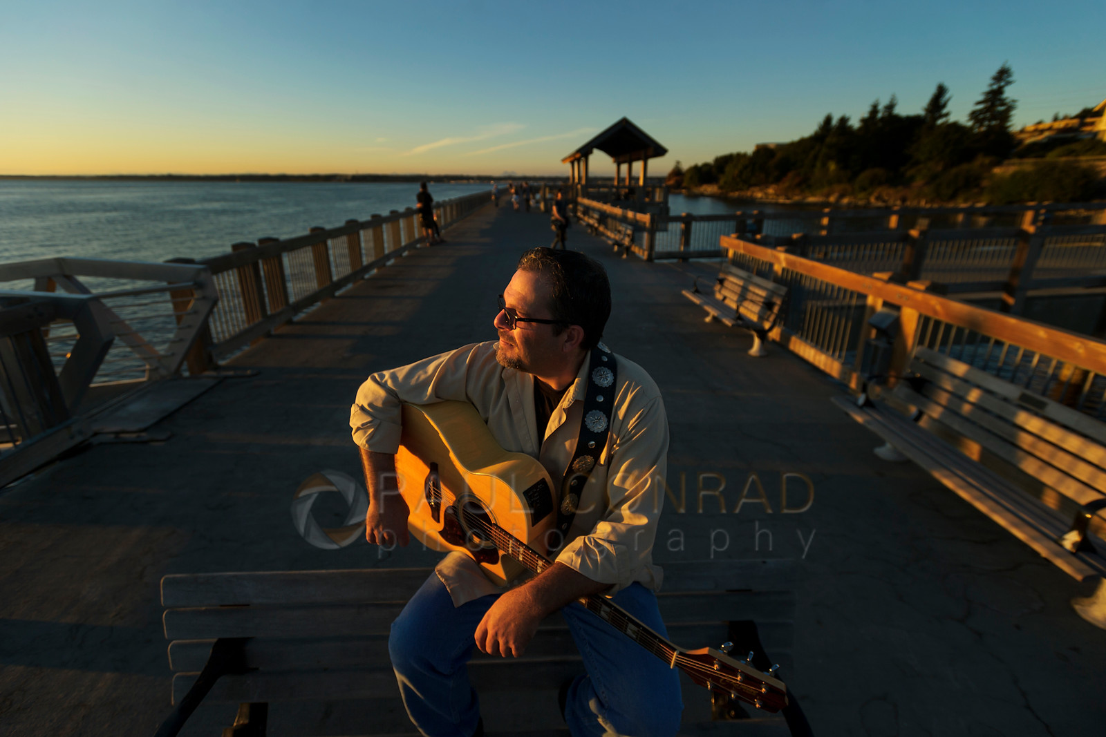 Bellingham Musician Brian Hoffpauer at Boulevard Park during a sunset photo shoot. Book yours today!!!