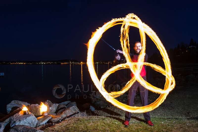 Celtic Triad - Fire dancer Ignus Amar'e of Everlife Entertainment forms a Celtic Triad while demonstrating his skill on Wednesday evening Jan. 4, 2016, at Boulevard Park in Bellingham, Wash. (© Paul Conrad/Paul Conrad Photography)
