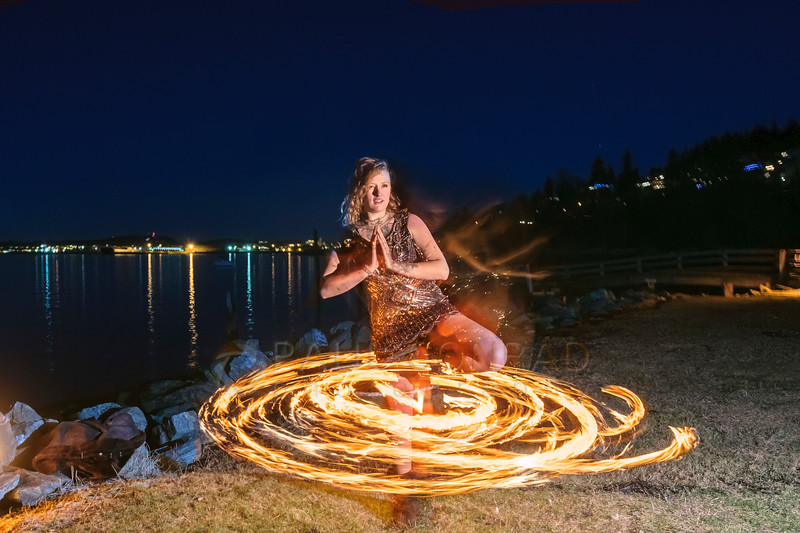 Balance - Fire dancer Tettra Hydra of Everlife Entertainment performs her routine on Wednesday evening Jan. 4, 2016, at Boulevard Park in Bellingham, Wash. (© Paul Conrad/Paul Conrad Photography)