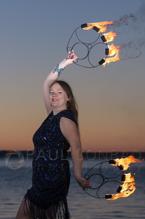 Fire performer Ericka Baumgarter of Everlife Entertainment demonstrates her skills on Wednesday evening Jan. 4, 2016, at Boulevard Park in Bellingham, Wash. (© Paul Conrad/Paul Conrad Photography)