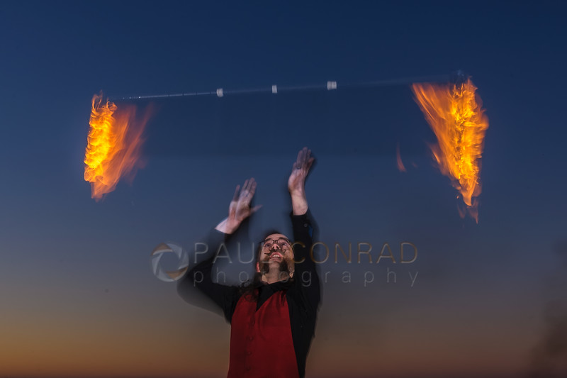 Exposure Test - Fire performer Ignus Amar'e, and Ericka Baumgarter of Everlife Entertainment demonstrating his skill on Wednesday evening Jan. 4, 2016, at Boulevard Park in Bellingham, Wash. (© Paul Conrad/Paul Conrad Photography)