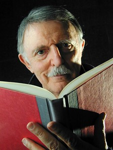 John Astin- Famous actor who once played Gomez Addams on the original Adams Family Series. He is now teaching Drama Classes at Johns Hopkins University and is shown here in a portrait while reading a Book. MF-D 4/11/01. Credit- The Daily Record