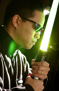 "Calvin Ho, Actor Editor and Choriographer in the amature film ""Art of the Saber"". Portriat with a plastic Jedi Light Saber. MF-D 2/6/04. Credit- The Daily Record"