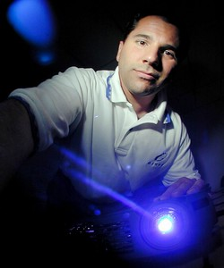 Lawrence M. Fiorino- CEO and Founder of G1440. Here he leans over a computer projector with a Blue light beam shoting out of the lens. MF-D 10/27/00. Credit- The Daily Record