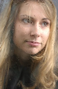 Heather Marcus behind a rain soaked window. MF-D 10/16/02.