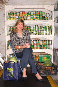 10.27.10 BALTIMORE, MD. Kristen P. Herber, attorney with Tydings & Rosenberg, LLP. Portraits at the food bank that she volunteers with. (Maximilian Franz/ The Daily Record)