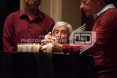 Marthe Cohn lighting remembrance candles.  Chabad Park City.
