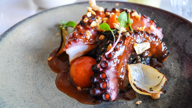 BBQ octopus, on top of black potatoes in a Peruvian type of causa, from A Cevicheria in Lisbon.