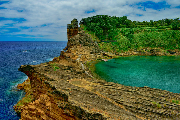 Island lake and ocean from cliffs HDR