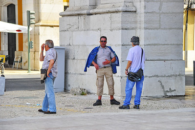 As our tour group entered the Commerce Plaza the guide pointed out three individuals she recognized as pick-pockets.  They kept eying our group wanting to join us.  The guy in the blue jacket made an rude gester to me after I took this photo.  They left the area on a bus.