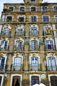 Lisbon apartment building with balcony out the window