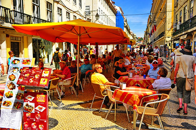A pedestrian mall which went for blocks lined with open air sidewalk cafes