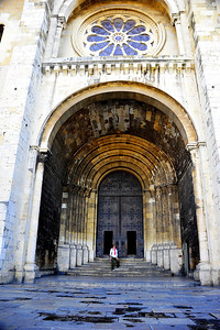 Lisbon Cathedral door way is a massive arched structure