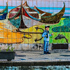 Boy In Front of Fishing Mural