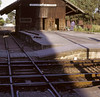 Senhora da Hora station, August 1972.  Goods shed and crossing.  The single track led from the Matosinhos branch, closed in 1965.  Photo by Les Tindall.