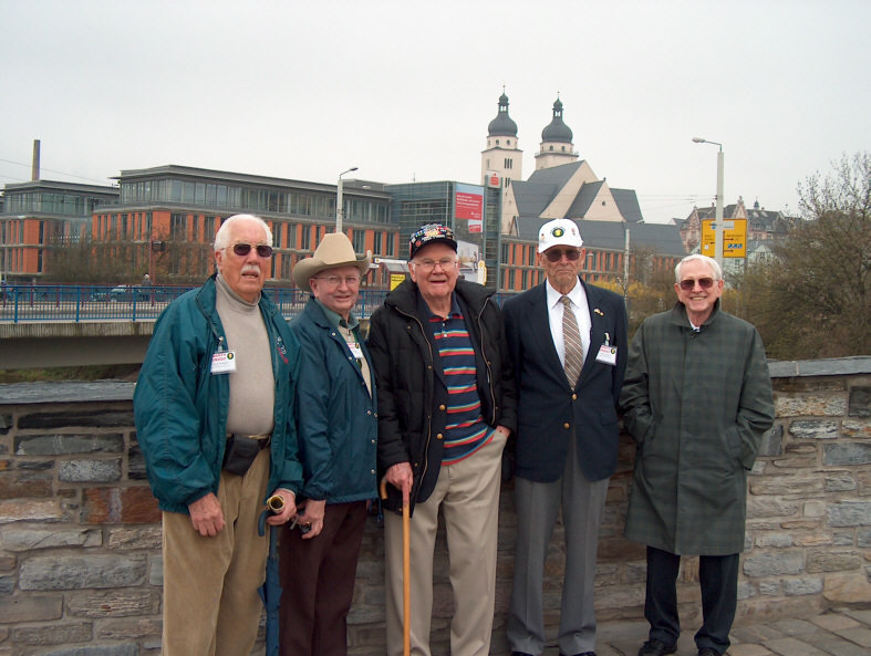 Veterans of 87th Infantry Division on Stony Elsterbridge in<br /> Plauen. From left to right: Jesse Bowman, Eldon Gracy, Tom Stafford, Tom Burgess, Gene Garrison