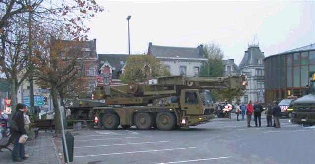 SHERMAN TANK - McAULIFFE SQUARE - BASTOGNE, BELGIUM<br /> November 6, 2006<br /> <br /> Here are some pictures taken by Guy Peremans, of COBRA and CRIBA, showing the main phases of the picking up of the Sherman Tank from the McAuliffe Square in Bastogne, Belgium, for restoration on<br /> Tuesday, November 6, 2006.<br /> <br /> The tank will stay in the Rocourt Arsenal until next April or May and will be cleaned, repainted and refitted. <br /> All the inhabitants of Bastogne are already waiting for its come back.<br /> <br /> Submitted by:<br /> Roger Marquet<br /> Honorary Lifetime Member of the 11th Armd Division Association.<br /> <br /> Centre Etude Battaile Ardennes<br /> ( C.E.B.A. )<br /> The Center for the Study of the Battle of the Ardennes is the study group in Luxembourg.<br /> <br /> A similar group exists in Belgium.....<br /> Centre pour Research et Information de Battaile Ardennes.. ( C.R.I.B.A )<br /> The Center for Research and Information of the Battle of the Ardennes.<br /> <br /> Voici, photographiées par Guy Péremans, vice président COBRA et membre du CRIBA, les phases principales de l'enlêvement du char de la Place McAuliffe à Bastogne, le lundi 6 novembre 2006. Le char a été emmené à l'Arsenal de Rocourt (près de Liège) où il sera lavé, décapé, poncé, sablé et repeint. Il sera aussi remis en état (roues, chenilles, tourelle, mitrailleuse,...). Son retour est prévu pour avril ou mai 2007. Les Bastognards l'attendent déjà avec impatience.