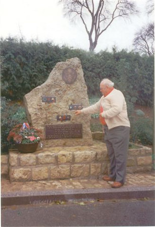 "Bill Roshek; 87th Division ""Recon""<br /> points to the Golden Acorn Icon on the steele at OSWEILER, Luxumbourg .....where the 87th Division liberated, around <br /> January 23, 1945.<br /> <br /> Bill Roshek of Cheyenne, Wyoming was with<br /> the Veterans of the Battle of the Bulge GALAXY TOUR group in 1994."