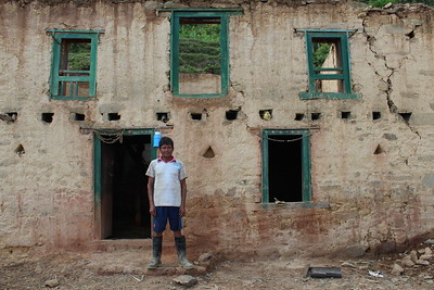 Man Standing in Front of His Home Scheduled for Deconstruction. Irkhu VDC, Sindhupalchowk. June 18th.