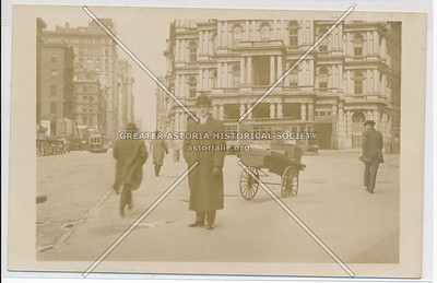 Man standing in front of old Post Office, off Broadway