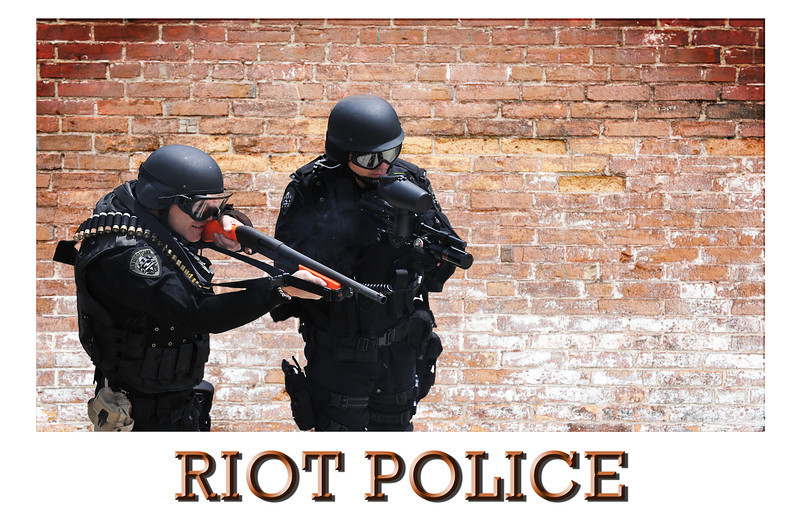 Riot Police aiming weapons
