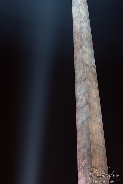 Gateway Arch at Night with beam of light