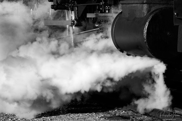 Steam issues from the piston on Nevada Northern Railway Locomotive #40