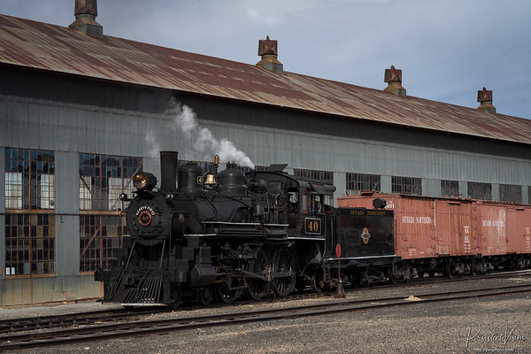 Locomotive #40 runs by the Repair-In-Place building