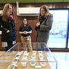 The area's first pot dispensary Sanctuary Medicinals in Gardner held its official ribbon cutting on January 4, 2019. Gardner City Councilor Lizzy Kazinskas, on left, and her sister Stacey Kazinskas, a board member of the Greater Gardner Chamber of Commerce, listen to Acting Dispensary Manager Forest Steinberg, center, as she informs them all about their shop and what they sell. SENTINEL & ENTERPRISE/JOHN LOVE