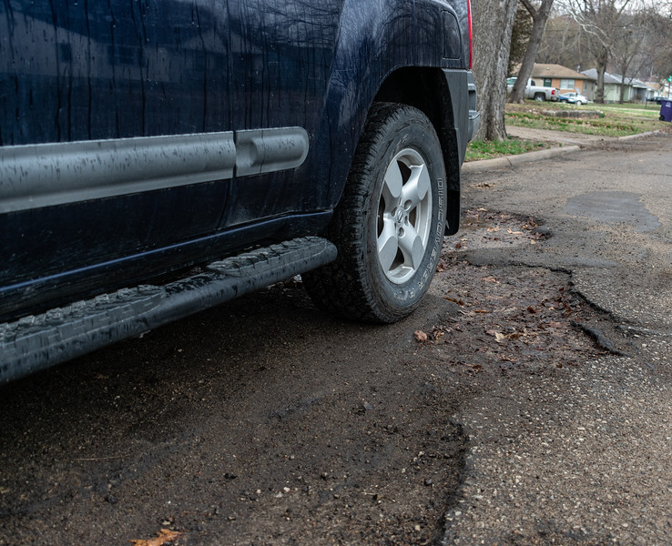 Due to an extremely cold and wet winter, potholes have become a nuisance for Manhattan's residents. Deep potholes cover just about every street and have become a threat for cars and bikes. (Brooke Barrett | Collegian Media Group)