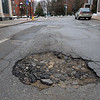 Grove Street in Fitchburg. Pothole on SENTINEL & ENTERPRISE/JOHN LOVE