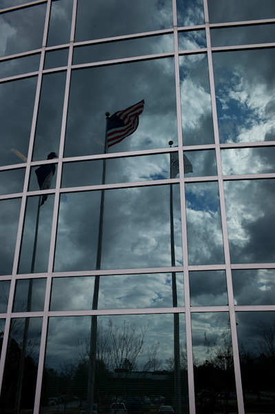 Flag reflections on a cloudy and windy day, Innsbrook, Glen Allen, Virginia