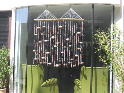 Bamboo windchime used as a window curtain especially designed for Sminu Jindal's house.Cost-Rs. 22,000.