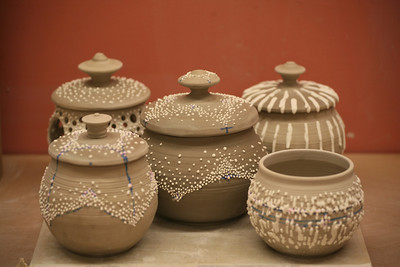 Newly finished jars drying before their first firing.