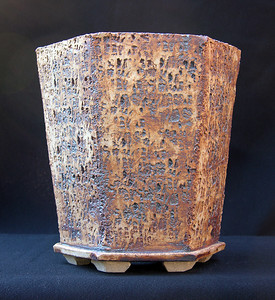 Limestone impressed stoneware. Hexagon 7.5 x 6.5 x 7.75 inches sold