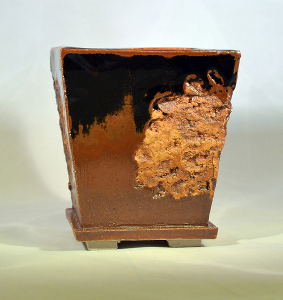 Iron oxide on lava impressed pot temnoku glaze  4.25 x 4.25 x 5 sold
