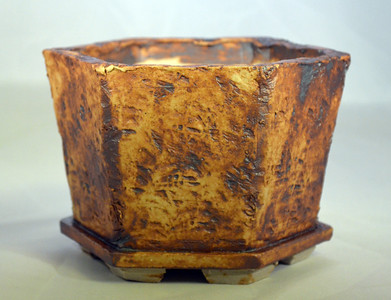 Iron oxide on lava impressed pot 7 x 6 x 4.5 sold