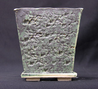 Green and Black Glaze over Rock impressed Stoneware.  This is the most unpredictable glaze iwork with.  Other sides are mostly black.  Rock is lava from Hector Mine, CA 5 x 5 x 5 sold