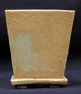 Stoneware pot green to brown glaze