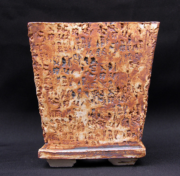 Stoneware impressed with Limestone collected between Barstow and Death Valley Iron Oxide stain 4 1/2 square by 4 3/4 sold