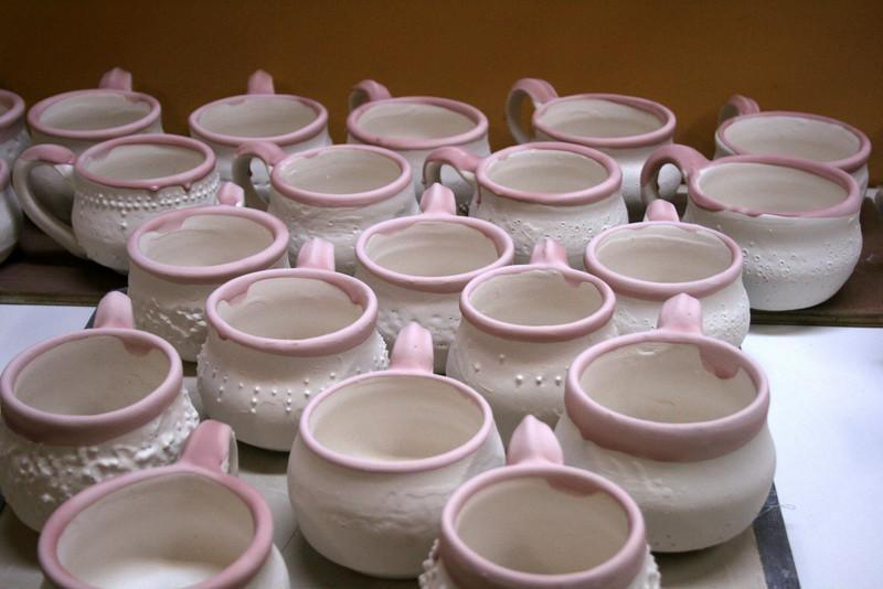 Glazed Mugs waiting to be fired.<br /> To see these mugs in person go to Cafe Lift. <br /> 428 North 13th St. Philadelphia, PA 19123 <br /> 215.922.3031